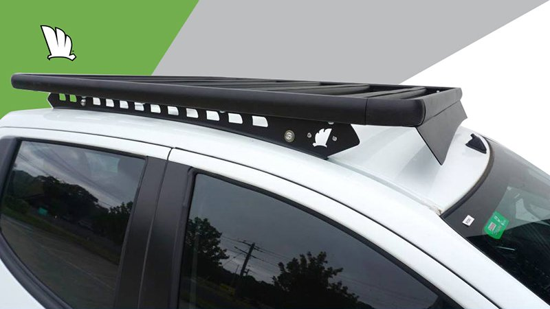 Close up image of the cabin of the Toyota HiLux dual cab with a Wedgetail roof rack installed showing the one piece mounting rail and the wind deflector.